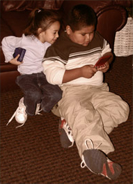 Specialist Piestewa's children play with GameBoys