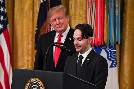 President Donald J. Trump posthumously awards the Medal of Honor to Staff Sgt. Travis W. Atkins at the White House in Washington D.C., March 27, 2019. Atkins' son, Trevor Oliver, speaks to those in attendance at the ceremony. Atkins was posthumously awarded the Medal of Honor for actions while serving with Delta Company, 2nd Battalion, 14th Infantry Regiment, 2nd Brigade Combat Team, 10th Mountain Division, in Abu Sarnak, Iraq, in support of Operation Iraqi Freedom, on June 1, 2007. His extraordinary heroism in attempting to subdue a suicide bomber and shielding three Soldiers from the imminent explosion resulted in him being mortally wounded and saving the Soldiers. (U.S. Army photo by Spc. James Harvey)