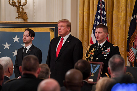 President Donald J. Trump posthumously awards the Medal of Honor to Staff Sgt. Travis W. Atkins at the White House in Washington D.C., March 27, 2019. Atkins was posthumously awarded the Medal of Honor for actions while serving with Delta Company, 2nd Battalion, 14th Infantry Regiment, 2nd Brigade Combat Team, 10th Mountain Division, in Abu Sarnak, Iraq, in support of Operation Iraqi Freedom, on June 1, 2007. His extraordinary heroism in attempting to subdue a suicide bomber and shielding three Soldiers from the imminent explosion resulted in him being mortally wounded and saving the Soldiers. (U.S. Army photo by Spc. James Harvey)