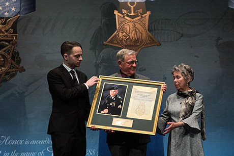 Mr. David L. Norquist, performing the duties of the U.S. deputy secretary of defense, posthumously inducts U.S. Army Staff Sgt. Travis Atkins into the Pentagon's Hall of Heroes during a ceremony with the Atkins' family at the Pentagon in Washington, D.C., March 28, 2019. The induction will add Atkins' name to the in the Hall of Heroes, the Department of Defense's permanent display of record for all recipients of the Medal of Honor. (DOD photo by U.S. Army Sgt. Amber I. Smith)