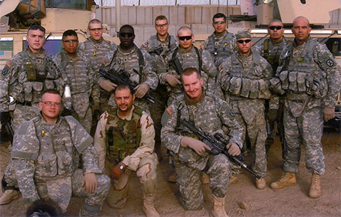 Then-Sgt. Travis Atkins poses with battle buddies in Iraq, 2007. (Photo courtesy of the Atkins family)