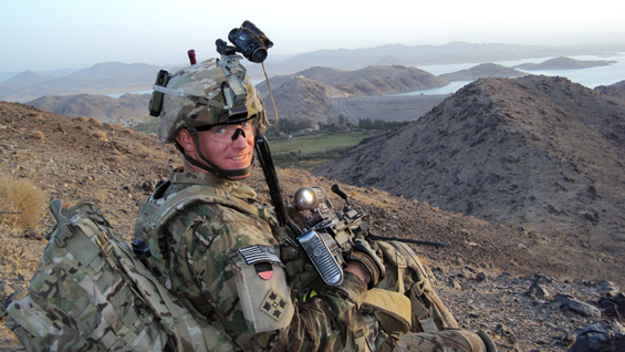 Staff Sgt. Ty Carter provides overwatch on a road near Dahla Dam, Afghanistan, July 2012.