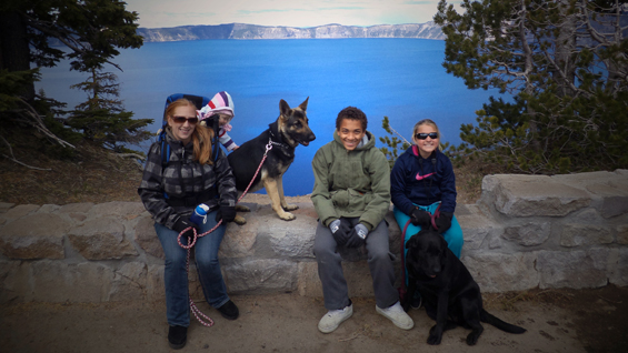 Staff Sgt. Ty Carter's wife Shannon, his daughter Sehara, his son Jayden, and his daughter Madison, along with family dogs Nala and Karma, pause for a photo along the rim of Crater Lake, Ore., during a family vacation, June 2013.