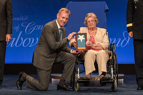 Deputy Secretary of Defense Patrick M. Shanahan presents Pauline Lyda Wells Conner, the spouse of U.S. Army 1st Lt. Garlin M. Conner, the Medal of Honor flag at the Pentagon, in Arlington, Va., June 27, 2018. Conner was posthumously awarded the Medal of Honor, June 26, 2018 for actions while serving as an intelligence officer during World War II on Jan. 24, 1945.  (U.S. Army photo by Spc. Anna Pol)