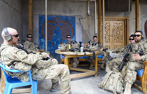 From left, then-Sgt. Addison Clark, 1st Lt. Florent Groberg, Pfc. Benjamin Secor, Sgt. 1st Class Brian Brink, Sgt. Andrew Mahoney and Spc. Daniel Balderrama of the brigade command group's personal security detail, 4th Infantry Brigade Combat Team, 4th Infantry Division, take some downtime during a deployment to Kunar Province, Afghanistan, 2012. (Courtesy photo)