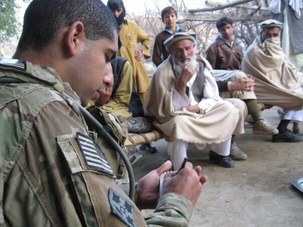 Then-U.S. Army 2nd Lt. Florent Groberg conducts a key leader engagement meeting in Kunar Province, Afghanistan, February 2010. (Courtesy of Retired Capt. Florent Groberg)