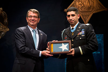 Secretary of Defense Hon. Ash Carter presents the Medal of Honor Flag to retired U.S. Army Capt. Florent Groberg during his Hall of Heroes induction ceremony Nov. 13, 2015, at the Pentagon, Arlington, Va. (U.S. Army photo by Mr. John G. Martinez)