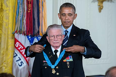President Barack Obama presents the Medal of Honor to retired U.S. Army Lt. Col. Charles Kettles for conspicuous gallantry, in the East Room of the White House, July 18, 2016. Then-Maj. Kettles distinguished himself in combat operations near Duc Pho, Republic of Vietnam, on May 15, 1967 and is credited with saving the lives of 40 Soldiers and four of his own crew members. White House photo by Chuck Kennedy