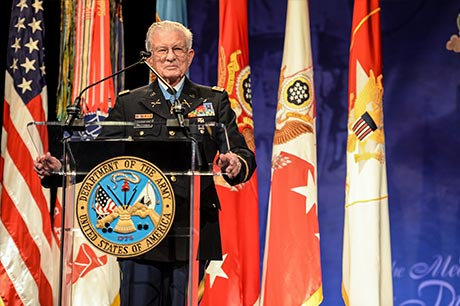Retired Lt. Col. Charles Kettles speaks to the audience during his induction ceremony to the Hall of Heroes at the Pentagon, in Arlington, Va., July 19, 2016, for actions during a battle near Duc Pho, South Vietnam, May 15, 1967.