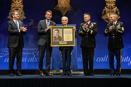 Secretary of Defense Ashton Carter, Secretary of the Army Eric Fanning, Vice Chief of Staff Gen. Daniel Allyn and Sgt. Maj. of the Army Daniel Dailey present a framed Medal of Honor citation to retired Lt. Col. Charles Kettles during the Hall of Heroes Induction Ceremony at the Pentagon, in Arlington, Va., July 19, 2016, for actions during a battle near Duc Pho, South Vietnam, on May 15, 1967. Photo by Sgt. Alicia Brand