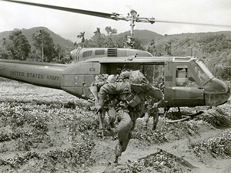 101st Airborne Soldiers move away from the landing zone after being dropped off by a 176th Aviation Company Huey helicopter during Operation Wheeler, 1967. (Photo courtesy of U.S. Army Heritage and Education Center, Vietnam War Photograph Collection)