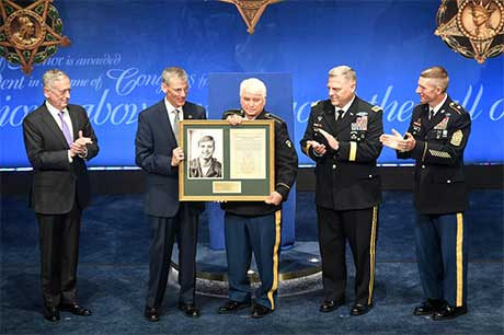Acting Secretary of the Army Robert M. Speer presents a citation to former Spc. 5 James C. McCloughan during the Medal of Honor Induction Ceremony at the Pentagon, in Arlington, Va., Aug. 1, 2017. McCloughan was awarded the Medal of Honor for distinguished actions as a combat medic assigned to Company C, 3rd Battalion, 21st Infantry Regiment, 196th Infantry Brigade, Americal Division, during the Vietnam War near Don Que, Vietnam, from May 13 to 15, 1969. U.S. Army photo by Spc. Tammy Nooner