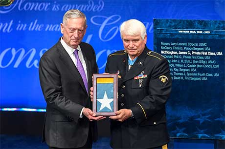 Secretary of Defense James Mattis presents the Medal of Honor flag to former Spc. 5 James C. McCloughan during the Medal of Honor Induction Ceremony at the Pentagon, in Arlington, Va., Aug. 1, 2017. McCloughan was awarded the Medal of Honor for distinguished actions as a combat medic assigned to Company C, 3rd Battalion, 21st Infantry Regiment, 196th Infantry Brigade, Americal Division, during the Vietnam War near Don Que, Vietnam, from May 13 to 15, 1969. U.S. Army photo by Sgt. Alicia Brand