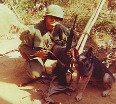 U.S. Army Pfc. James McCloughan poses with a dog while on a patrol in Vietnam, 1969. (Photo courtesy of former U.S. Army Spc. 5 James McCloughan)