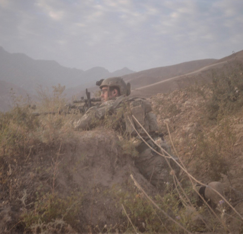 Sgt. Maj. Payne in Northern Afghanistan in 2014. Payne and his unit had been ambushed on this same hill the day prior. (Photo courtesy of Sgt. Maj. Thomas P. Payne)