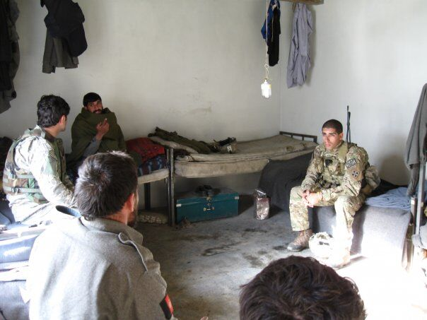 Then-U.S. Army 2nd Lt. Florent Groberg conducting a meeting with local Afghan National Police in Kunar Porvince, Afghanistan in January 2010. (Courtesy of Retired Capt. Florent Groberg)
