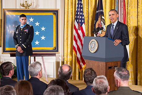 President Barack Obama hosts the Medal of Honor Ceremony for retired U.S. Army Capt. Florent Groberg at the White House in Washington D.C., Nov. 12, 2015. Groberg received the medal for actions during a combat engagement in Kunar province, Afghanistan, Aug. 8, 2012 while he was the commander of a personal security detail for the 4th Brigade Combat Team, 4th Infantry Division, when he and another Soldier, Sgt. Andrew Mahoney, identified and tackled a suicide bomber, saving the lives of the brigade commander and several others. (U.S. Army photo by Eboni L. Everson-Myart)