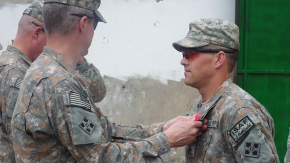 Staff Sergeant Romesha receiving bronze star