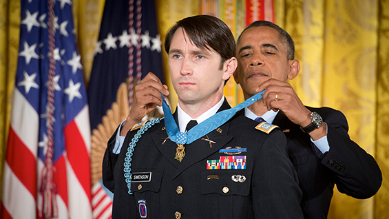 President Barack Obama presents the Medal of Honor to former Army Capt. William D. Swenson, citing his extraordinary heroism in the Battle of Ganjgal, in Kunar Province, Afghanistan.