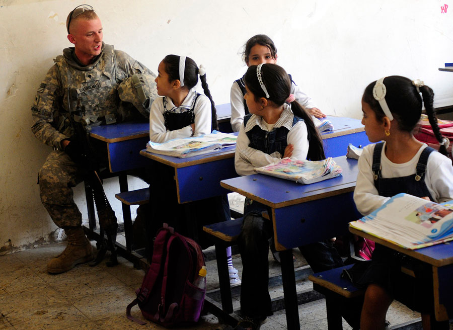 School girls help Soldier with his vocabulary