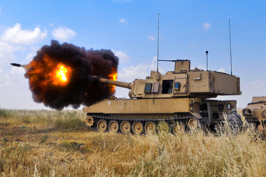 M109A6 Paladin fires 155mm round through cannon