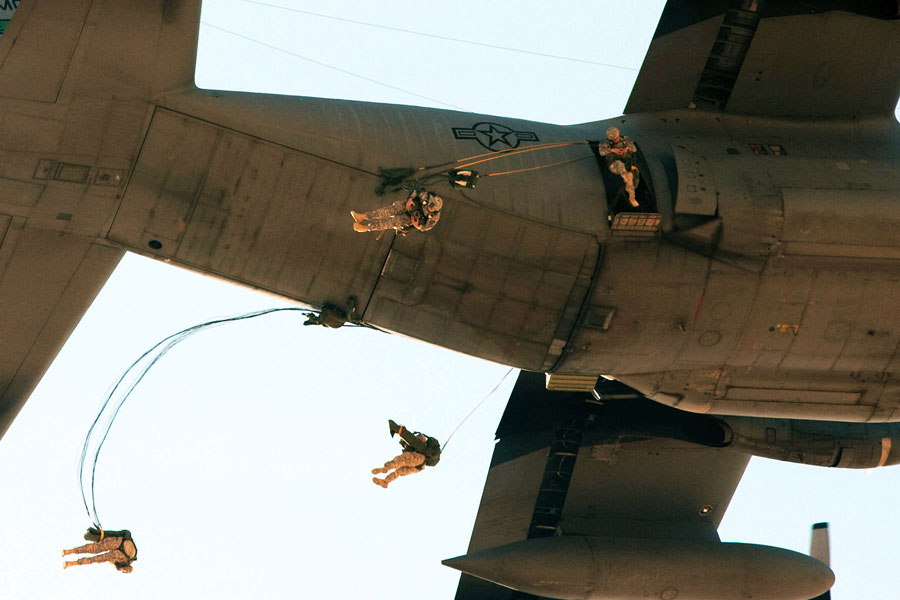 Paratroopers jump from C-130 aircraft