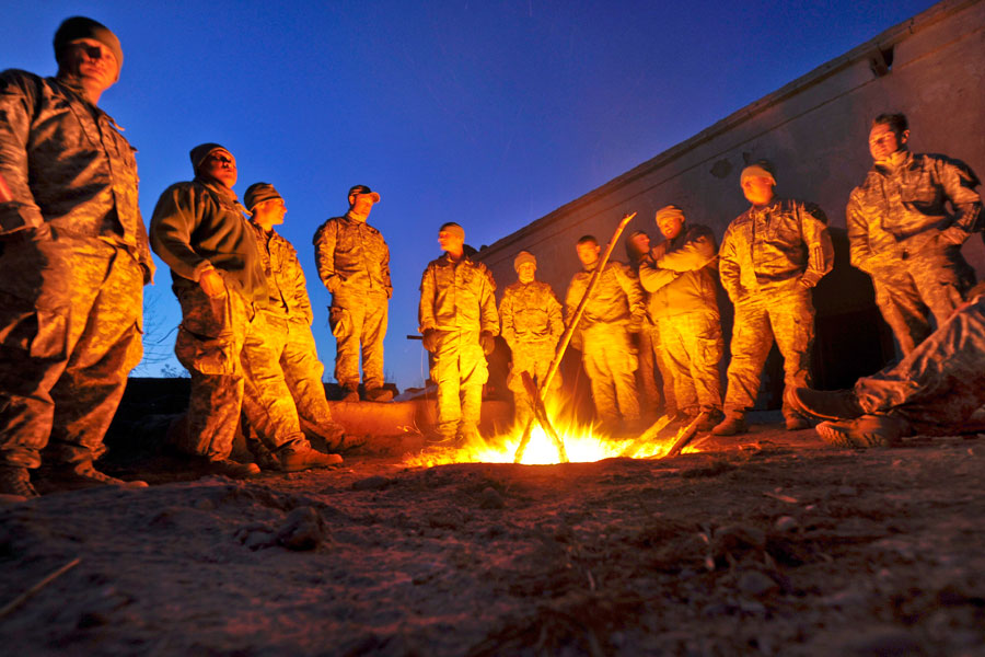 Alpha Company gathers around fire to stay warm