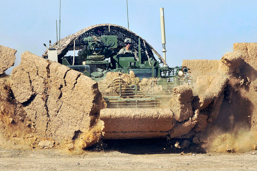 5th Stryker Brigade Combat Team breaks down wall