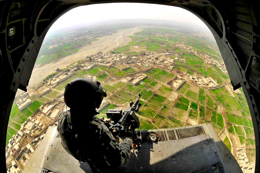 Aerial gunner provides aerial security from CH-47 Chinook helicopter above Khost Province, Afghanistan