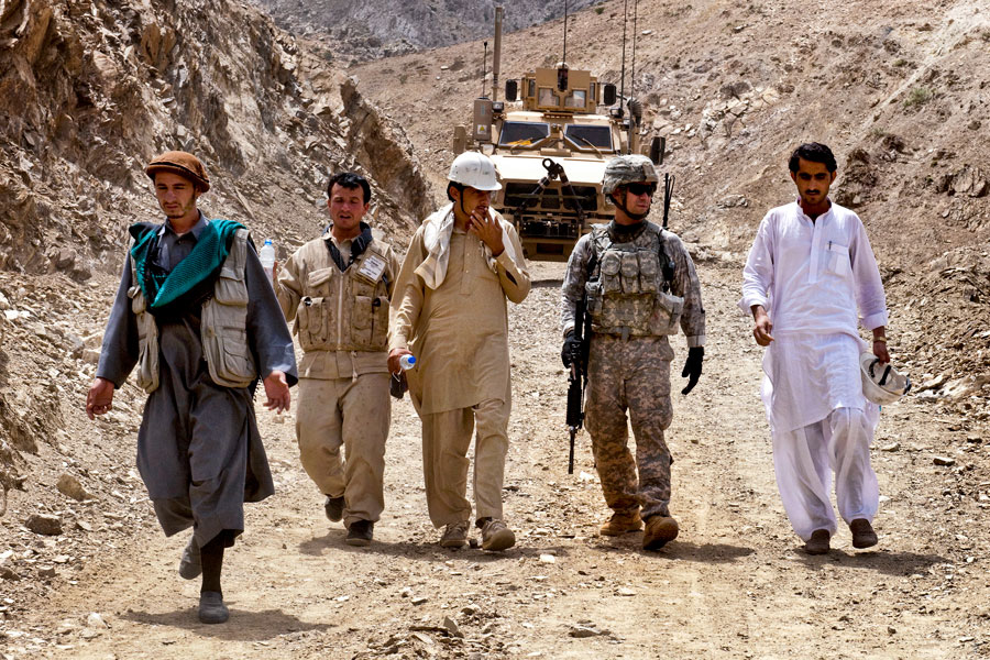 Soldier and local contractors discuss building road across district border of Nejrab