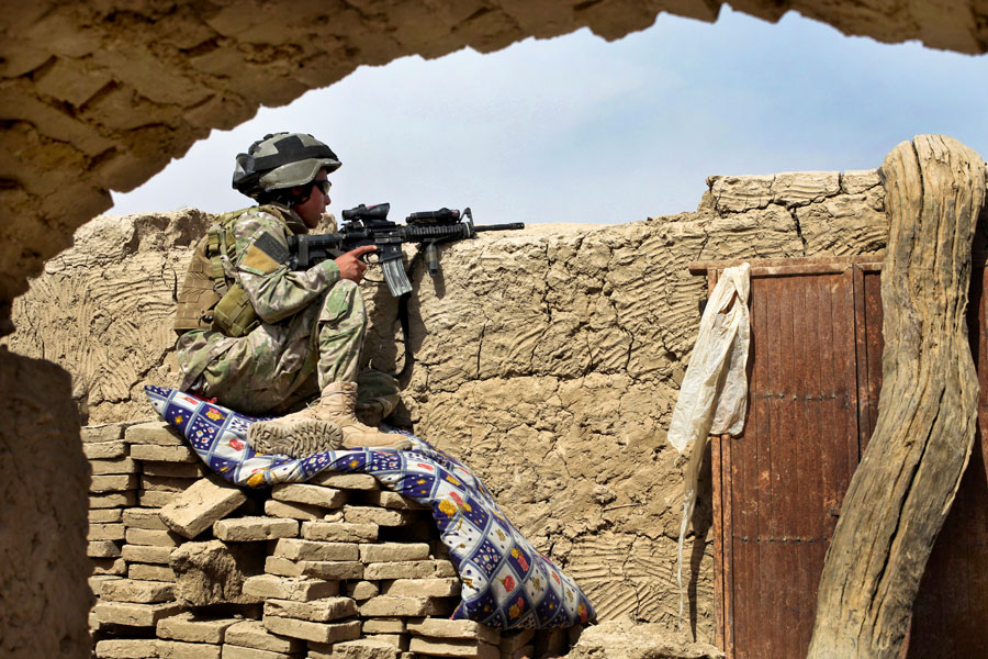 Afghan-international security force secures area with M-4 rifle