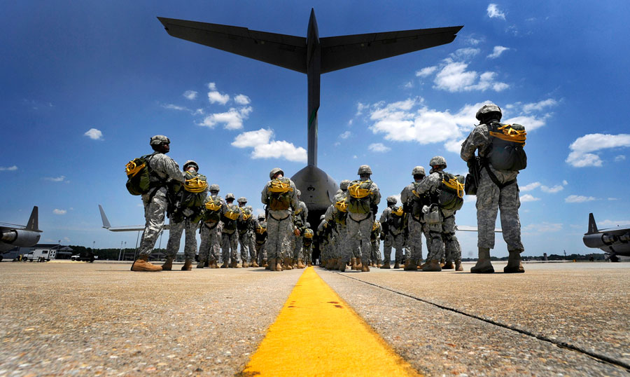 Paratroopers wait to board C-17 Globemaster III cargo aircraft
