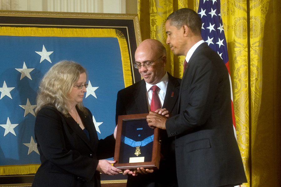 President Barack Obama presents the Medal of Honor posthumously to the parents of Staff Sergeant Robert J. Miller