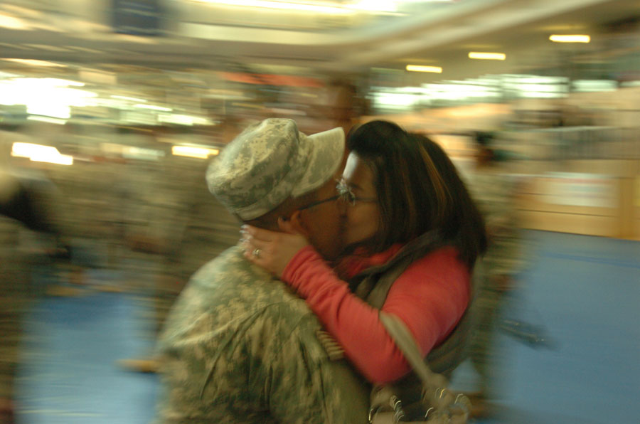 Soldier kisses his wife