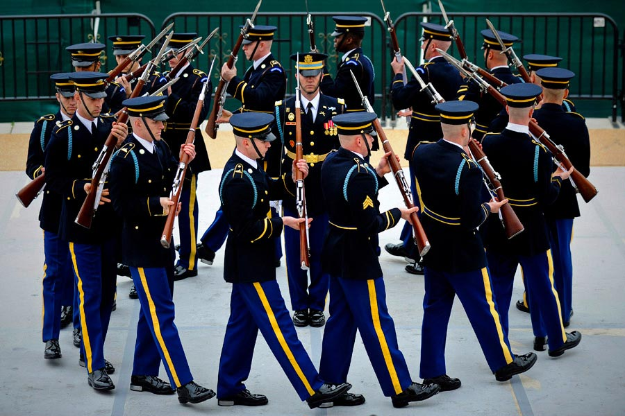 The United States Army Drill Team, 3rd United States Infantry Regiment (The Old Guard), performs in the 4th Annual Joint Service Drill Exhibition