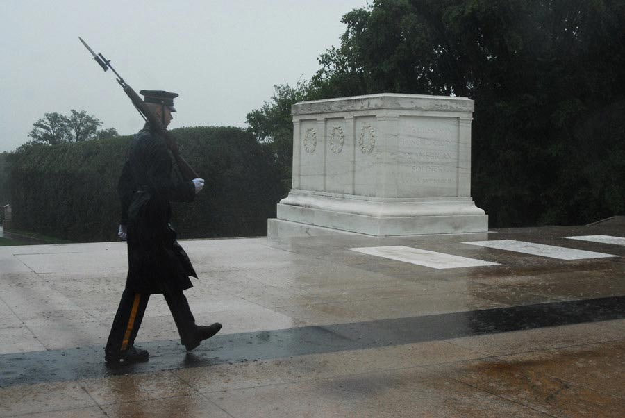 A lone Tomb Guard with the 3rd United States Infantry Regiment (The Old Guard), walks in humble reverence during Hurricane Irene at the Tomb of the Unknown Soldier, Arlington National Cemetery