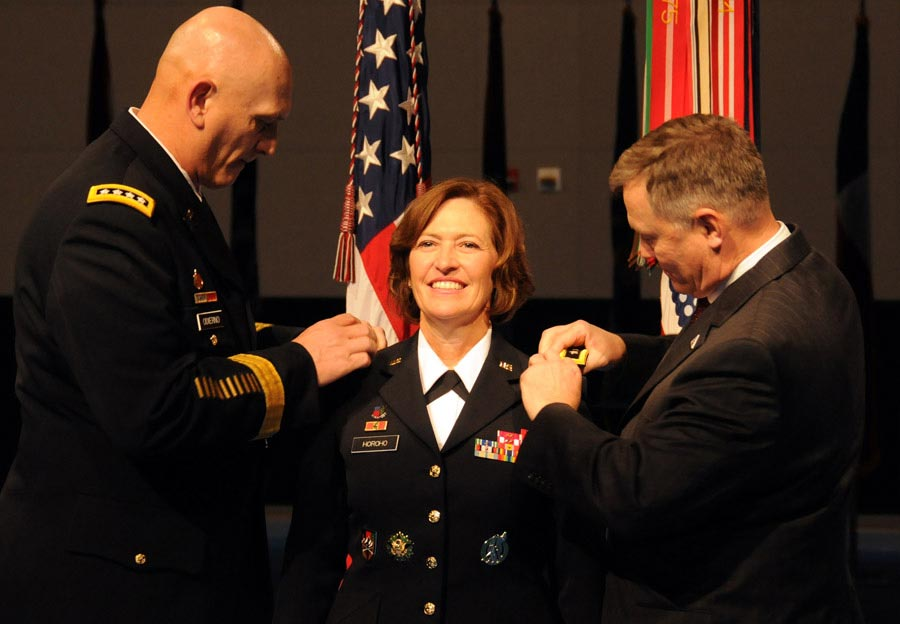Chief of Staff of the Army General Raymond T. Odierno and retired Colonel Ray Horoho pin three-star epaulets on the shoulders of Lieutenant General Patricia D. Horoho