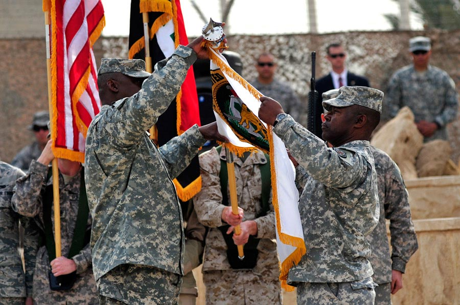 General Lloyd James Austin III and Command Sergeant Major Joseph R. Allen case the USF-I Colors during a ceremony that marked the end of Operation New Dawn