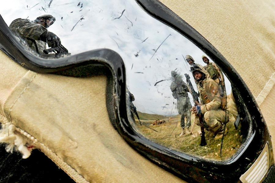 Reflection of Army Staff Sergeant Kevin Murphy in goggles instructing Iraqi soldiers