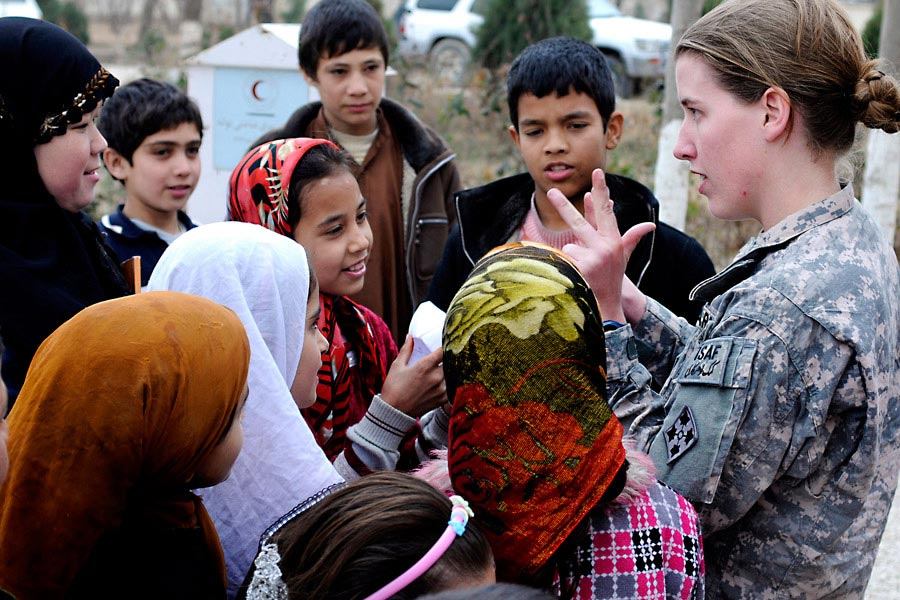 First Lieutenant Rebecca Wagner counts with Afghan children