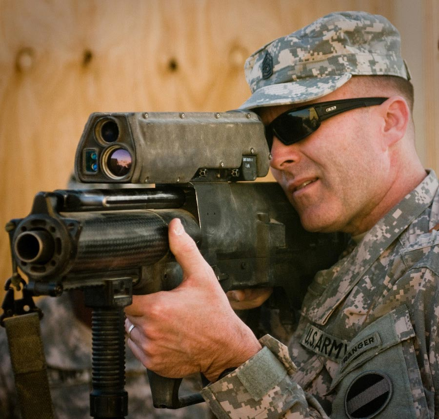Command Sergeant Major Ronald T. Riling looks through scope of an XM-25 Individual Airburst Weapon System