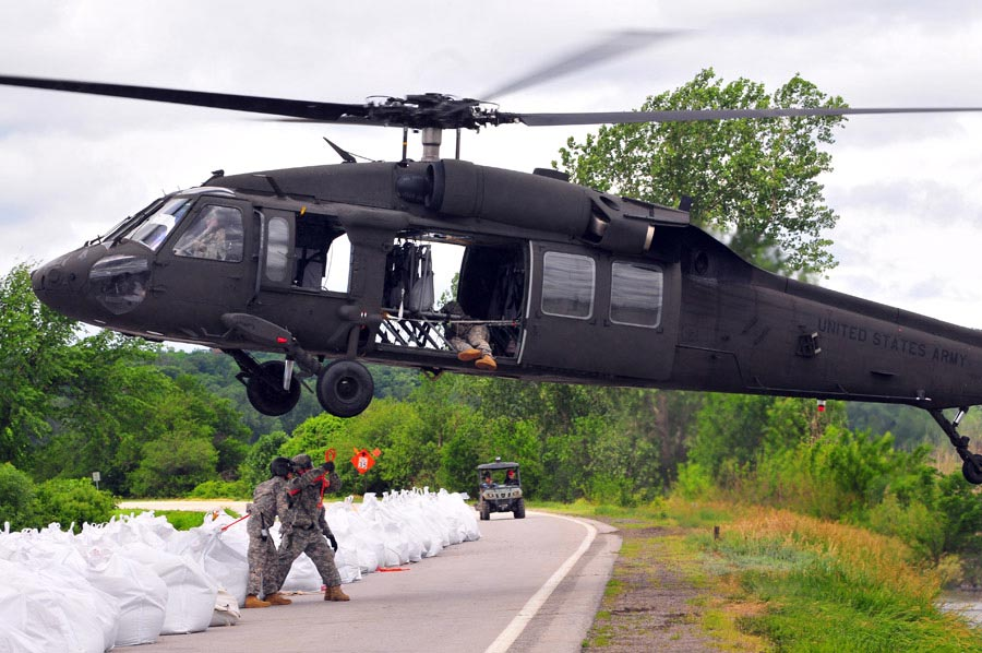 The Missouri National Guard assists Atchison County authorities with personnel and a UH-60 Black Hawk Helicopter to repair levee L550 near Phelps City, Missouri