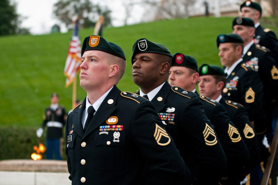 Special Forces Green Beret Soldiers from each of the Army's seven Special Forces Groups stand silent watch during the wreath-laying ceremony at the grave of President John F. Kennedy at Arlington National Cemetery