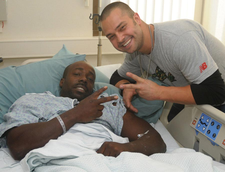 New York Yankees outfielder Nick Swisher meets a Wounded Warrior during his visit with patients and staff at Landstuhl Regional Medical Center