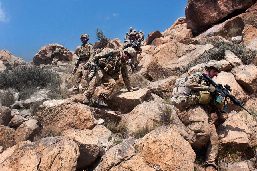 Soldiers begin their descend from the summit of Big Nasty
