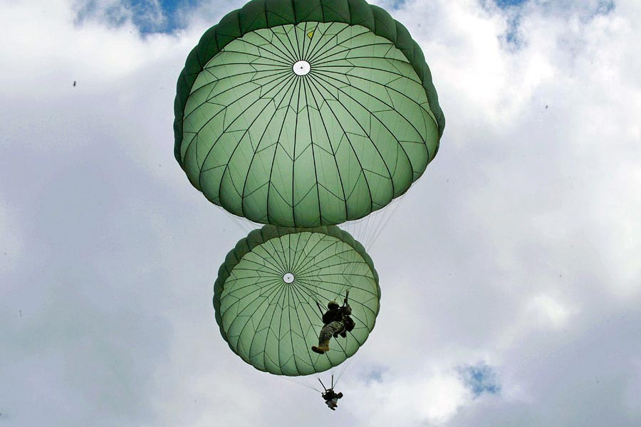 Paratroopers from the 82nd Airborne Division descend to the ground after jumping out of a C-17 Globemaster III aircraft