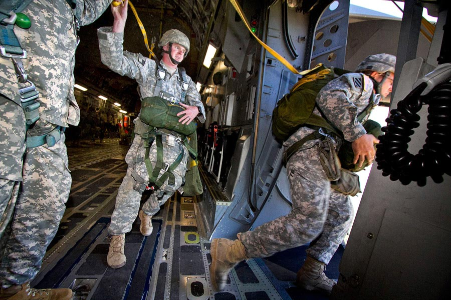 Paratroopers exit a C-17 Globemaster III during an airborne training exercise