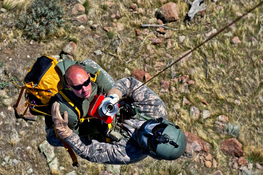 Sergeant Nathan McLaughlin, from Utah Army National Guard, rescues lost hiker, during search and rescue training exercise