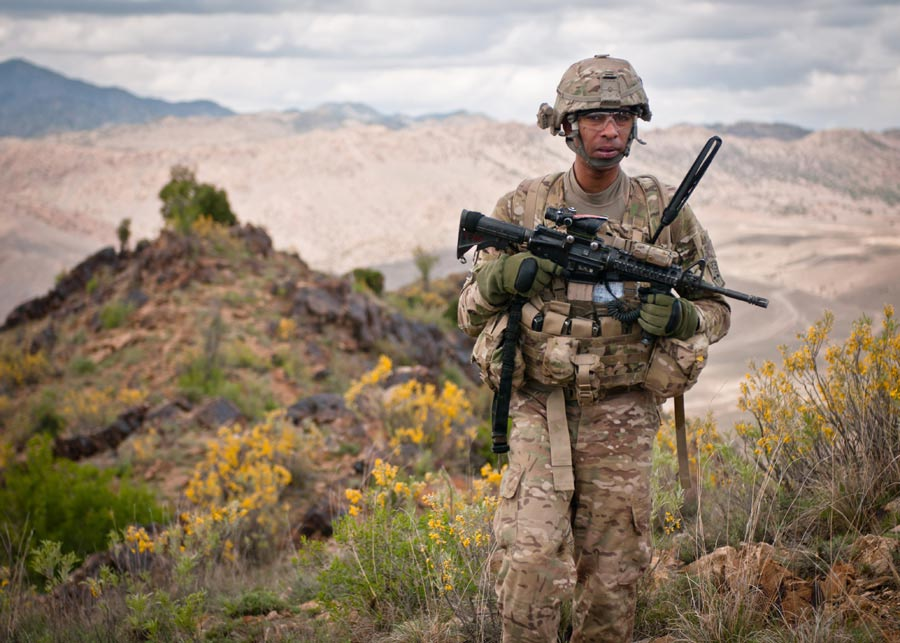 Sergeant First Class Raja Richardson, platoon sergeant with 172nd Infantry Brigade, leads patrol across ridgeline