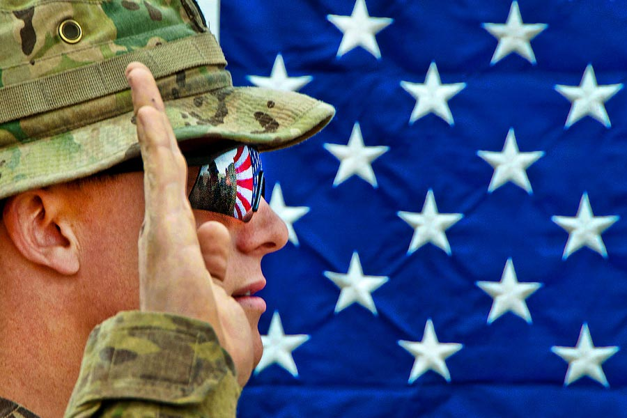 American flag reflects in the glasses of an officer with the 82nd Airborne Division